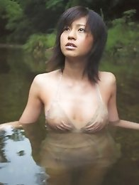 Misako Yasuda Asian in bath suit relaxes in water and in her car