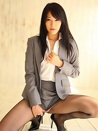 Gorgeous asian secretary in a short skirt and black pantyhose