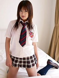 Sexy asian school girl slowly gets undressed and shows her bikini