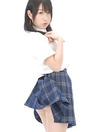 Adorable busty asian school girl lifts up her plaid skirt