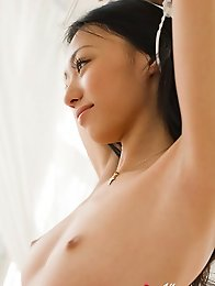 Beautiful asian babe shows her perfect naked petite boobs
