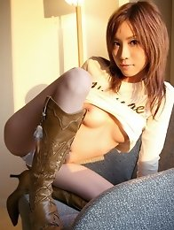 Sexy and slutty Japanese av idol Chinatsu Izawa strips naked in a hotel during the sunset