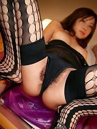 Sexy and horny Japanese av idol Chinatsu Izawa wwears sexy stockings and strips naked
