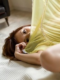 Redhead Japanese Natsuki Yoshinaga takes off her dress to show a nice body