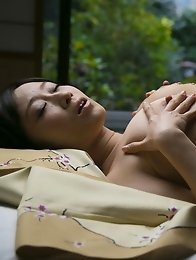 Sexy and mature Japanese av idol Yu Kawakami lies down to get a sexual naked massage