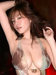 Sexy gravure idol temptress sreams it up in her skimpy swim suit