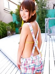 Yukari Sato looks beautiful in her green polka dot bikini