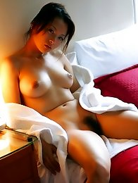 Japan model Koisaya strip and poses in bedroom